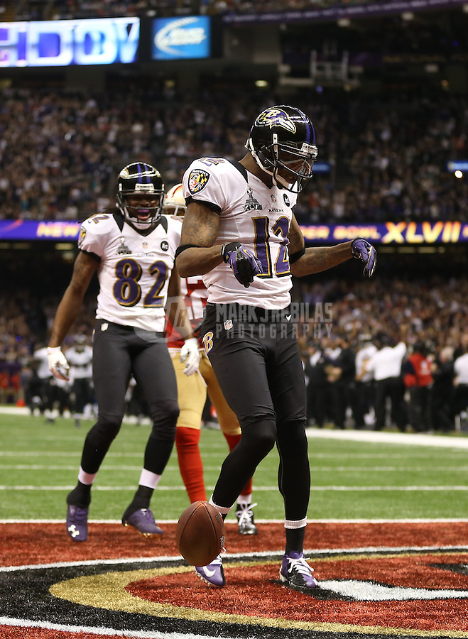 Feb 3, 2013; New Orleans, LA, USA; Baltimore Ravens wide receiver Jacoby Jones (12) celebrates with wide receiver Torrey Smith (82) after scoring a touchdown against the San Francisco 49ers in the second quarter in Super Bowl XLVII at the Mercedes-Benz Superdome. Mandatory Credit: Mark J. Rebilas-