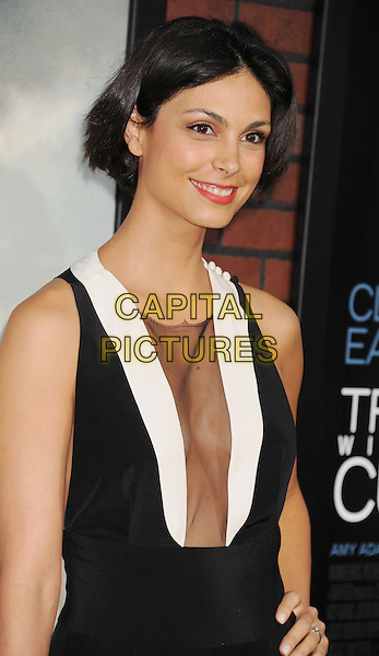"Morena Baccarin.""Trouble With The Curve"" Los Angeles Premiere held at the Regency Village Theatre, Westwood, California, USA..September 19th, 2012.half length white hand on hip dress sleeveless plunging neckline cleavage sheer black.CAP/ROT/TM.©Tony Michaels/Roth Stock/Capital Pictures"
