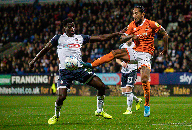 Bolton Wanderers' Josh Emmanuel competing with Blackpool's Sean Scannell (right) <br /> <br /> Photographer Andrew Kearns/CameraSport<br /> <br /> The EFL Sky Bet League One - Bolton Wanderers v Blackpool - Monday 7th October 2019 - University of Bolton Stadium - Bolton<br /> <br /> World Copyright © 2019 CameraSport. All rights reserved. 43 Linden Ave. Countesthorpe. Leicester. England. LE8 5PG - Tel: +44 (0) 116 277 4147 - admin@camerasport.com - www.camerasport.com