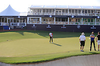 Shane Lowry (IRL) and his team on the 18th green during the preview for the DP World Tour Championship at the Earth course,  Jumeirah Golf Estates in Dubai, UAE,  18/11/2015.<br /> Picture: Golffile | Thos Caffrey<br /> <br /> All photo usage must carry mandatory copyright credit (&copy; Golffile | Thos Caffrey)