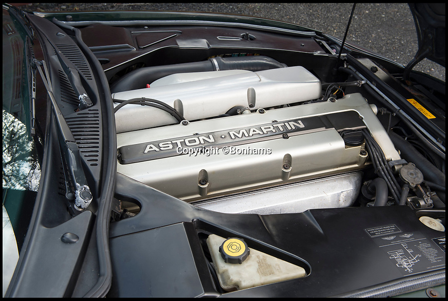 BNPS.co.uk (01202 558833)Pic: Bonhams/BNPS<br /> <br /> 3.2 litre V8.<br /> <br /> By Royal Appointment - The Aston Martin DB7 built for Prince Andrew in 1996. <br /> <br /> An Aston Martin convertible, formerly owned by HRH Prince Andrew, has emerged for sale for just £35,000.<br /> <br /> The green DB7 was built specifically for the Prince and his family in 1996 and he owned it for the first year of its life.<br /> <br /> The Duke of York eventually parted with the bespoke sports car in 1997 and since then it has been in the hands of a number of different owners - all of whom have kept it to an exceptionally high standard.<br /> <br /> A photograph remains to this day of Andrew driving the car with his then wife Sarah Ferguson in the passenger seat. The couple were accompanied by their two young children Princess Eugenie and Princess Beatrice, who were sat in the back.
