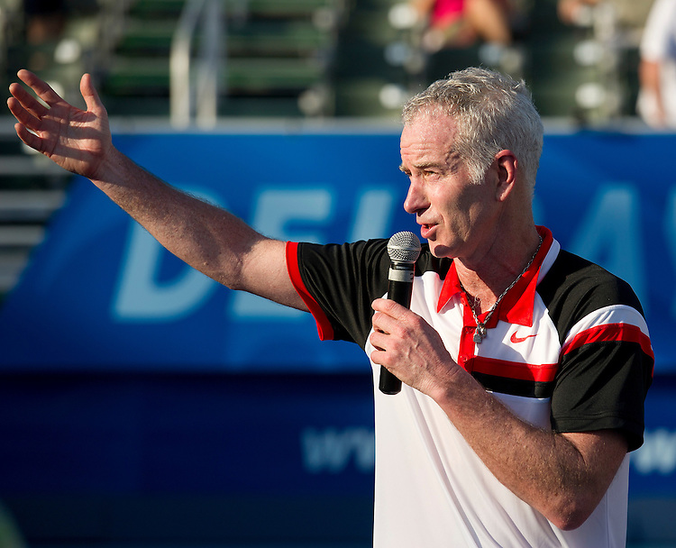 John McEnroe (USA) accepts his runners-up trophy after defeat by Carlos Moya (ESP) in their Final match today - C Moya (ESP) d J McEnroe (USA) 6-4 6-2..Tennis - ATP Champions Tour - 2013 Delray Beach International Tennis Championships - Day 3 - Sunday 24th February 2013 - Delray Beach Stadium & Tennis Center - Delray Beach - Florida - USA..© CameraSport - 43 Linden Ave. Countesthorpe. Leicester. England. LE8 5PG - Tel: +44 (0) 116 277 4147 - admin@camerasport.com - www.camerasport.com