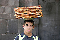 Simit seller, Diyarbakir, southeastern Turkey. Ring shaped pastry topped with sesame seeds