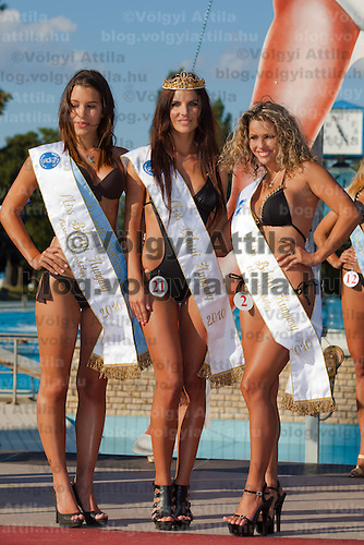 Three winners Fanni Krizsa (L), Vanda Szamos (C) and Livia Peter (R) placed third, first and second during the Miss Bikini Hungary beauty contest held in Budapest, Hungary. Sunday, 29. August 2010. ATTILA VOLGYI