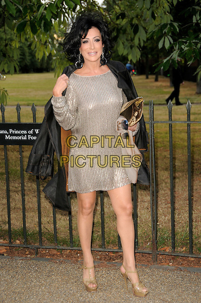 NANCY DELL'OLLIO.The Summer Party at The Serpentine Gallery, London, England. .July 9th, 2009 .full length black jacket silver dress sequins sequined taking off removing clutch bag dell olio.CAP/CAS.©Bob Cass/Capital Pictures.