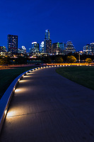 Another verticle image down this lighted view to the city at night of the Austin skyline as a backdrop to this verticle capture.  We like the way the lights on the walkway lead you down the path to this wonderful skyline image of downtown Austin.