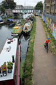 Cyclist on the towpath of the Lea Navigation canal, Hackney Wick, east London.