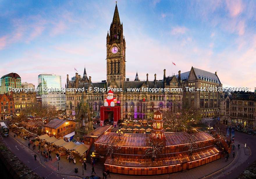 02/12/14<br /> <br /> ***A digitally stitched panoramic image made from seven exposures***<br />  <br /> As the sun sets, a giant Santa Claus overlooks the centrepiece of Manchester's Christmas market in Albert Square. The wooden buildings have all been built to accommodate the German style market which is spread over seven streets. <br /> <br /> ***ANY UK EDITORIAL PRINT USE WILL ATTRACT A MINIMUM FEE OF £130. THIS IS STRICTLY A MINIMUM. USUAL SPACE-RATES WILL APPLY TO IMAGES THAT WOULD NORMALLY ATTRACT A HIGHER FEE . PRICE FOR WEB USE WILL BE NEGOTIATED SEPARATELY***<br /> <br /> <br /> All Rights Reserved - F Stop Press. www.fstoppress.com. Tel: +44 (0)1335 300098