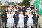 A great day for Joanne O'Connor Class from Moyderwell Primary School as her class made their first holy communion on Saturday in St John's Church, Tralee Front l-r: Ikechukwu Anyanwu, Aimee Kerins, Leon Dybauliass-Shalemba, Andrea O'Callaghan, Dylan O'Brien, Oliva Roman Conor O'Brien. 2nd row l-r: Tara Moriarty, maria Daly and Karol Jurecki.3rd row l-r: Thomas White and Robert Coffey. 4th row l-r: Bernice O'Shea, Jakub Ealas, Christina Oluwadare and James Franklin. Back row l-r: lauren O'Sullivan, George Reidy, Adrian Artur Cieslak and Klevis Cenalia..