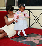 Actress Angela Bassett receives a star on the Hollywood Walk of Fame in Los Angeles, California on March 20, 2008. She poses with daughter Bronwyn Golden. Photopro.