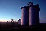 USA, Pacific Northwest; Washington State; Eastern Washington, Columbia Basin; Clyde, old grain elevator at dusk, dryland wheat country,