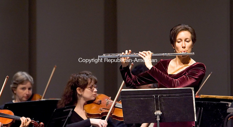 WATERBURY, CT- 18 NOV 2007- 111807JT03- .Flutist Kim Collins, of Trumbull, performs as a featured soloist during the Waterbury Symphony Orchestra's concert on Sunday at the Naugatuck Valley Community College Fine Arts Center in Waterbury. The program featured Bach, Vivaldi, and Mozart..Josalee Thrift / Republican-American