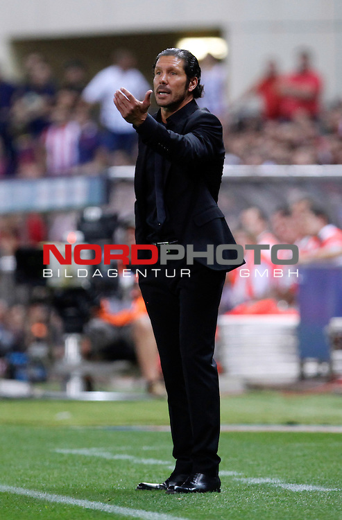 Atletico de Madrid's coach Cholo Simeone  during Supercup of Spain 1st match.August 21,2013. Foto © nph / Victor Blanco)