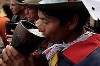 A man drinks beer during the Yawar Fiesta in the town of Coyllurqui in the Peruvian Andes on Independence Day.