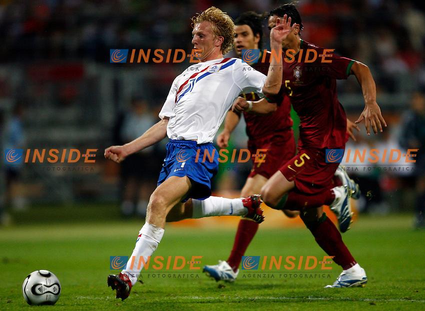 Nuremberg 25/6/2006 World Cup 2006 Ottavi di finale Portogallo Olanda 1-0.Photo Andrea Staccioli Insidefoto.Dirk Kuyt Netherlands Ricardo Costa and Fernando Meira of Portugal