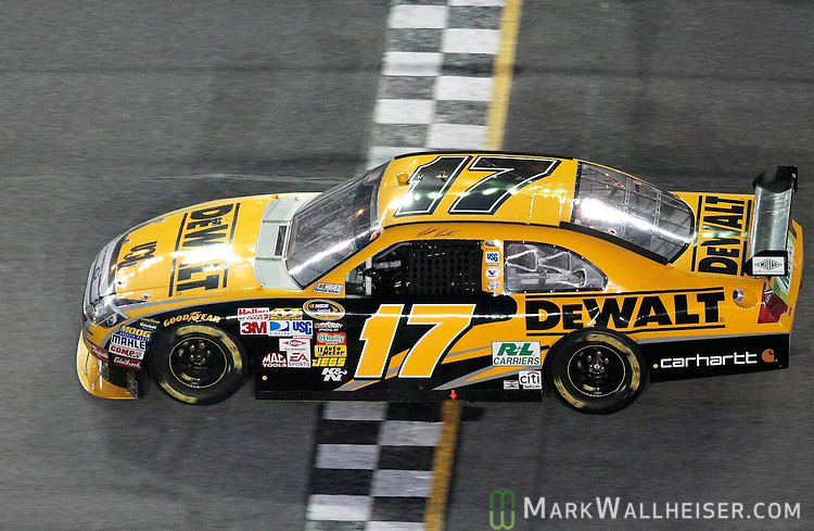 Matt Kenseth crosses the finish line to win the rain-shortened .51st Daytona 500 NASCAR Sprint Cup Series race at the Daytona International Speedway in Daytona Beach, Florida February 15, 2009.  (Mark Wallheiser/TallahasseeStock.com)
