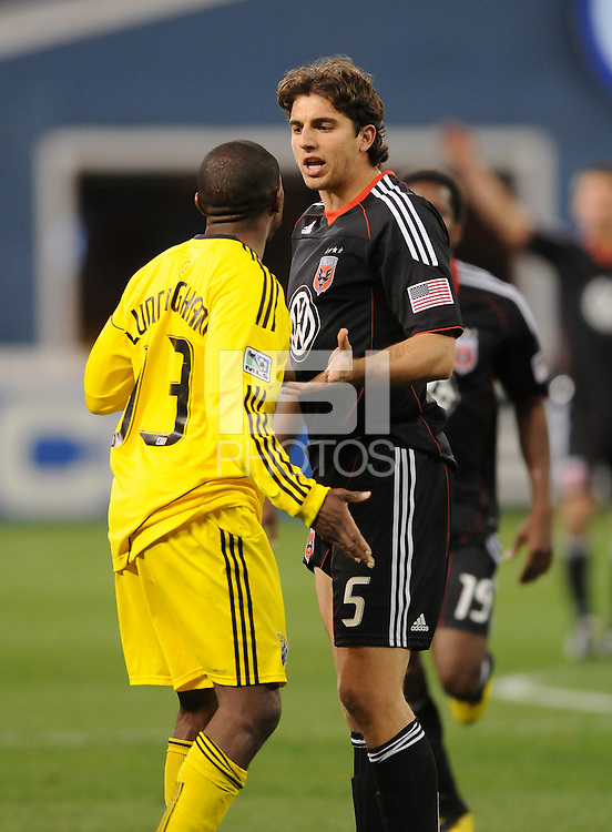 DC United defender Dejan Jakovic (5) argues with Columbus Crew forward Jeff Cunningham (33)  DC United defeated The Columbus Crew 3-1  at the home season opener, at RFK Stadium, Saturday March 19, 2011.