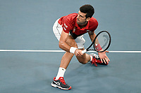 11th January 2020; Sydney Olympic Park Tennis Centre, Sydney, New South Wales, Australia; ATP Cup Australia, Sydney, Day 9; Serbia versus Russia;  Novak Djokovic versus Daniil Medvedev; Novak Djokovic of Serbia watches his midcourt volley against Daniil Medvedev of Russia - Editorial Use