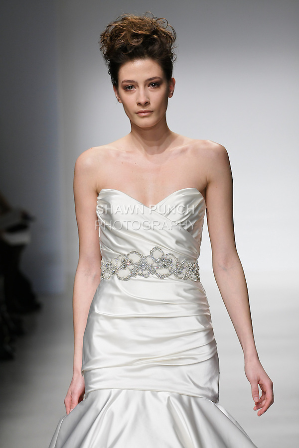 Model walks runway in an Anna wedding dresses by Amsale Aberra, for the Kenneth Pool Spring 2012 Bridal runway show.