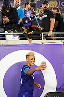 Orlando, Florida - Saturday, April 23, 2016: Orlando Pride forward Lianne Sanderson (10) takes a selfie with a couple of fans after their 3-1 victory during an NWSL match between Orlando Pride and Houston Dash at the Orlando Citrus Bowl.