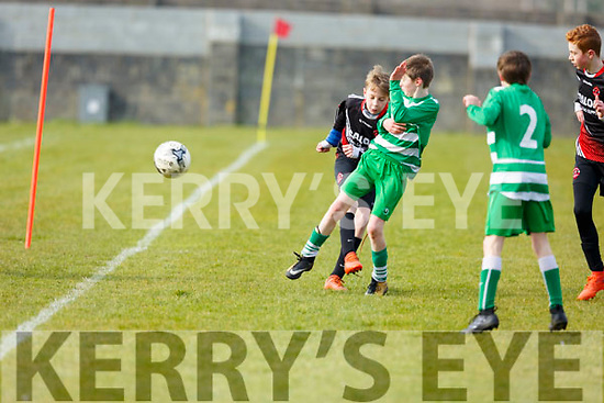 St Brendans Park Luke Casey clears the ball dispite the close marking from Killarneys Jason O'Sullivan during the  John Joe Naughton U13's Cup game, St Brendan's Park A v Killarney Celtic in Christy Leahy Park on Saturday last.