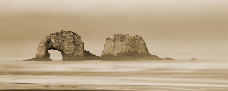 Sunrise  with Arch Rock. Rockaway Beach. Oregon