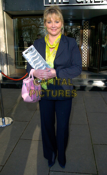 CHERYL BAKER.Leaving the TRIC Awards (Television and Radio Industries Club), Grosvenor House, Park Lane, .London, England, March 6th 2007..full length pink bag silver yellow scarf black pinstripe suit.CAP/CAN.©Can Nguyen/Capital Pictures