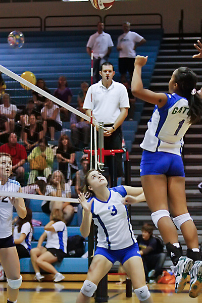 Senior Kim Lavoie sets up Junior Sommer King for the kill against Foothill High School.