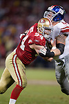 San Francisco 49ers defensive lineman Justin Smith (94) battles against New York Giants offensive lineman David Diehl (66) during an NFC Championship NFL football game on January 22, 2012 in San Francisco, California. The Giants won 20-17 in overtime. (AP Photo/David Stluka)