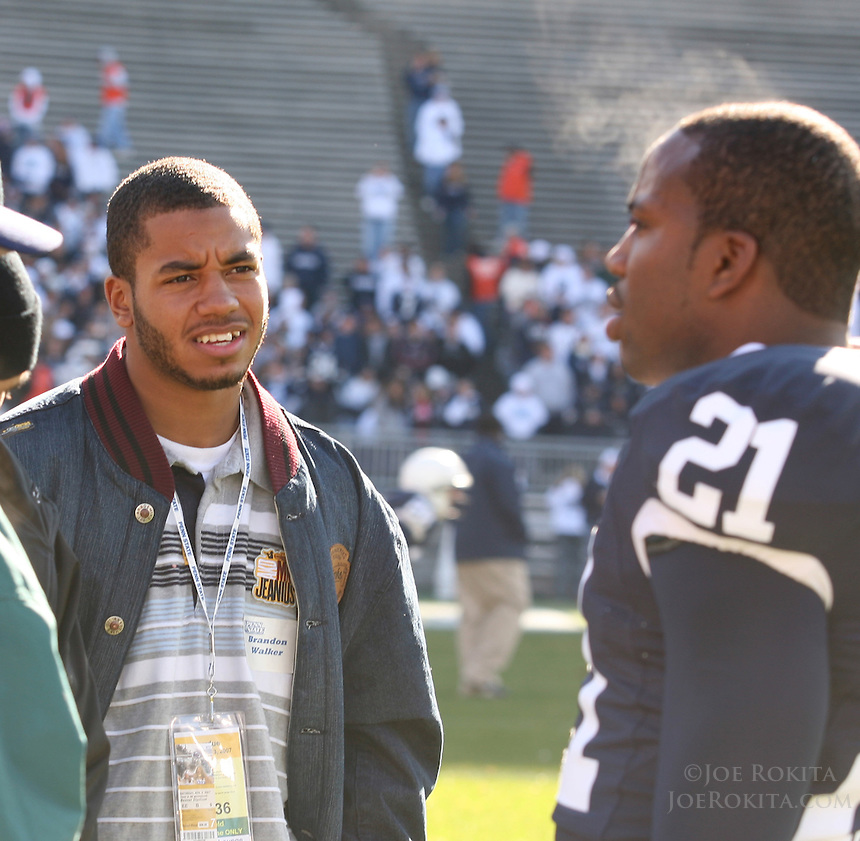State College, PA -- 11/3/2007 --  Steam comes from the forehead of Knowledge Timmons (right) as he talks with Brandon Walker, a recruit from York High School who was at the game, during pre-game warm-ups.  Penn State defeated Purdue by a score of 26-19 on Saturday, November 3, 2007, at Beaver Stadium...Photo:  Joe Rokita / JoeRokita.com