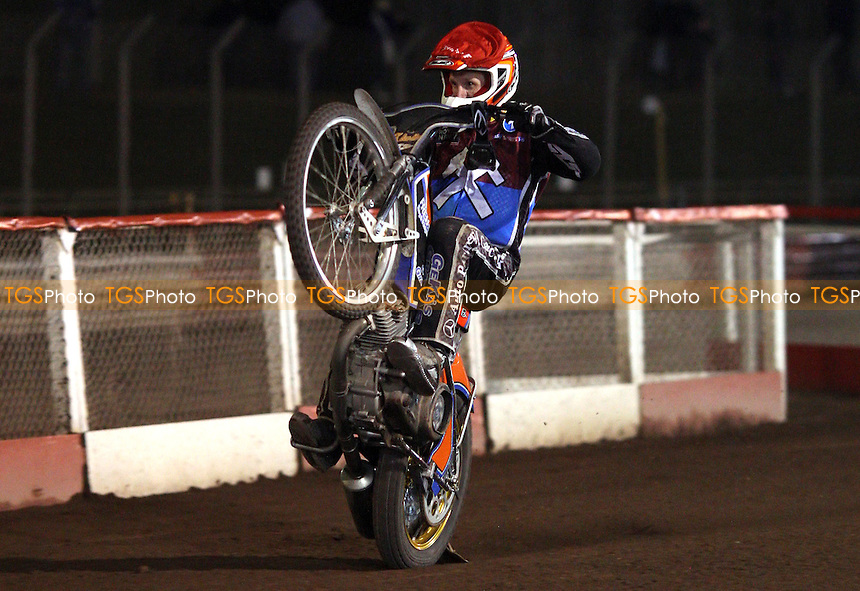 Peter Karlsson of Lakeside Hammers celebrates at the end of the meeting with a wheelie - Lakeside Hammers vs Belle Vue Aces, Elite League at the Arena Essex Raceway, Pufleet - 30/03/12 - MANDATORY CREDIT: Rob Newell/TGSPHOTO - Self billing applies where appropriate - 0845 094 6026 - contact@tgsphoto.co.uk - NO UNPAID USE..