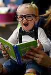 Benjamin Walker, 1, reads a book at the Boo-nanza event at the Carson City Library, in Carson City, Nev., on Tuesday, Oct. 30, 2018. <br /> Photo by Cathleen Allison/Nevada Momentum