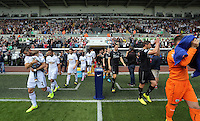 Pictured: The teams coming out of the tunnel. Saturday 23 August 2014<br />