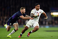 Manu Tuilagi of England is tackled. Guinness Six Nations match between England and Scotland on March 16, 2019 at Twickenham Stadium in London, England. Photo by: Patrick Khachfe / Onside Images