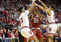 NWA Democrat-Gazette/CHARLIE KAIJO Arkansas Razorbacks forward Gabe Osabuohien (22) defends the ball from Indiana Hoosiers forward Juwan Morgan (13) and guard Rob Phinisee (10) during the first half of the NCAA National Invitation Tournament, Saturday, March 23, 2019 at the Simon Skjodt Assembly Hall at the University of Indiana in Bloomington, Ind. The Arkansas Razorbacks fell to the Indiana Hoosiers 63-60.