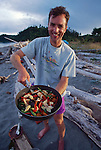 Sea kayak camping, Point No Point, Puget Sound, Salish Sea, Washington State, Pacific Northwest, USA, North America, man camp cooking, vegetable stirfry, beach camp site, Cary Gersten, model released, .