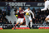 Barclays Premier League, West Ham United (red)V Swansea City Fc (white), Boelyn Ground, 02/02/13<br /> Pictured: Pablo Hernandez wins the volley against Winston reid<br /> Picture by: Ben Wyeth / Athena Picture Agency<br /> info@athena-pictures.com
