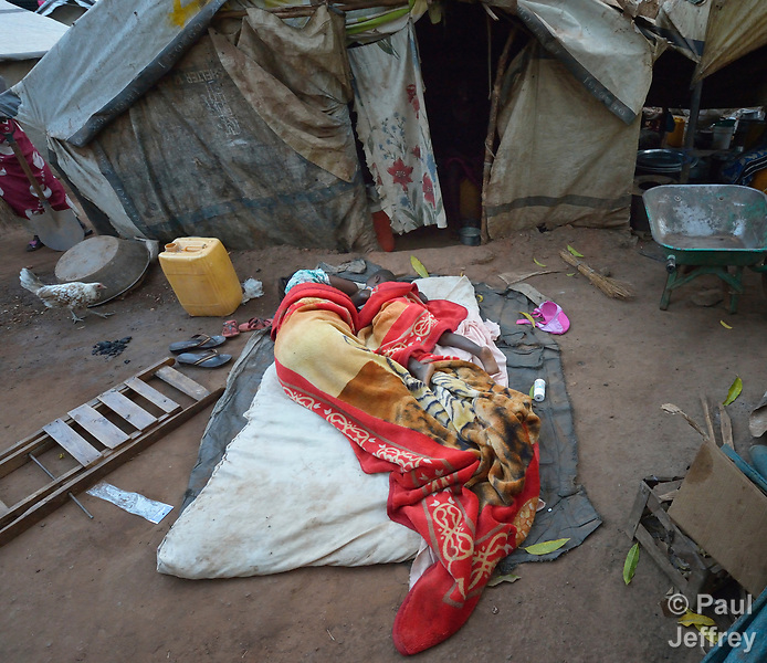 A family sleeps outside their makeshift shelter in a camp for more than 12,000 internally displaced persons located on the grounds of the Roman Catholic Cathedral of St. Mary in Wau, South Sudan. Most of the families here were displaced in June, 2016, when armed conflict engulfed Wau.<br /> <br /> Norwegian Church Aid, a member of the ACT Alliance, has provided relief supplies to the displaced in Wau, and has supported the South Sudan Council of Churches as it has struggled to mediate the conflict in Wau.
