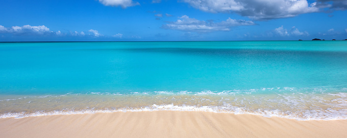 A serene morning looking out of teh crystal blue waters of the Leeward Islands, West Indies.