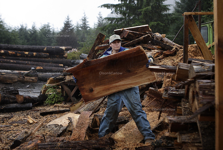 A worker moves lumber after logs are milled.   She works for Logger Dick.  Warren Jones owns WR Jones and Son Lumber Co in Craig.  He planes boards for molding, sells music wood and many specialty products.  He has been in business since the '70s--one of the many small mill operators on Prince of Wales island.