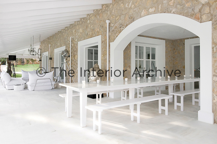 The spacious covered terrace which encircles the villa provides distinct areas to sit, relax and eat
