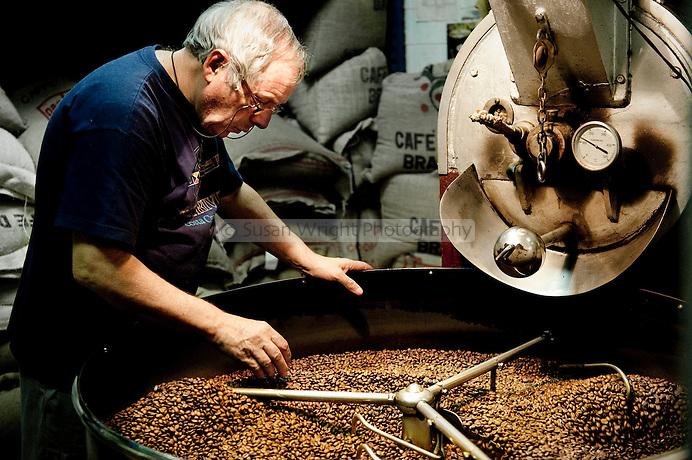 Man sorting through freshly roasted coffee beans, Sant Eustachio Cafe, Rome, Italy