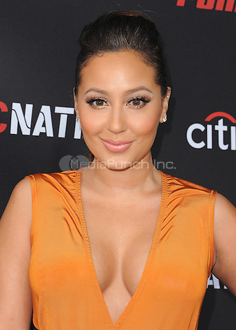 BEVERLY HILLS, CA - FEBRUARY 7:  Adrienne Bailon at the 5th Annual Roc Nation Pre-Grammy Brunch at Roc Nation offices on February 7, 2015 in Beverly Hills, California. SKPG/Mediapunch