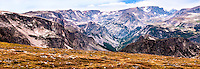 SUBJECT: Mountains IMAGE: From over 10,000 feet, cirques, small glaciers, glaciated valleys, scree slopes thin air an alpine meadows grace this tortuous terrain. The scale is deceptive. Valley floor is about 6,000 ft while the camera is over 10,000 feet. The pointed peak, top right, gave the range its name.