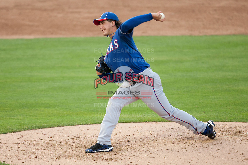 """Texas Rangers starting pitcher Derek Holland #45 delivers during the MLB exhibition baseball game against the """"AAA"""" Round Rock Express on April 2, 2012 at the Dell Diamond in Round Rock, Texas. The Rangers out-slugged the Express 10-8. (Andrew Woolley / Four Seam Images)."""