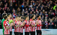 Lincoln City players during a minutes applause in memory of Kevin Austin<br /> <br /> Photographer Chris Vaughan/CameraSport<br /> <br /> The Emirates FA Cup Second Round - Lincoln City v Carlisle United - Saturday 1st December 2018 - Sincil Bank - Lincoln<br />  <br /> World Copyright © 2018 CameraSport. All rights reserved. 43 Linden Ave. Countesthorpe. Leicester. England. LE8 5PG - Tel: +44 (0) 116 277 4147 - admin@camerasport.com - www.camerasport.com
