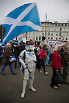 A figure dressed in a cartoon costume waving a Scottish saltire flag at a pro-independence gathering in George Square, Glasgow. The gathering brought together Yes Scotland supporters who favour Scotland leaving the union with the United Kingdom. On the 18th of September 2014, the people of Scotland voted in a referendum to decide whether the country's union with England should continue or Scotland should become an independent nation once again and leave the United Kingdom.