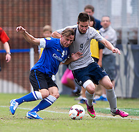 Vincent Keller (4) of Creighton fights for the ball with Alex Muyl (9) of Georgetown during the game at Shaw Field on the campus of the Georgetown University in Washington, DC.  Georgetown tied Creighton, 0-0, in double overtime.