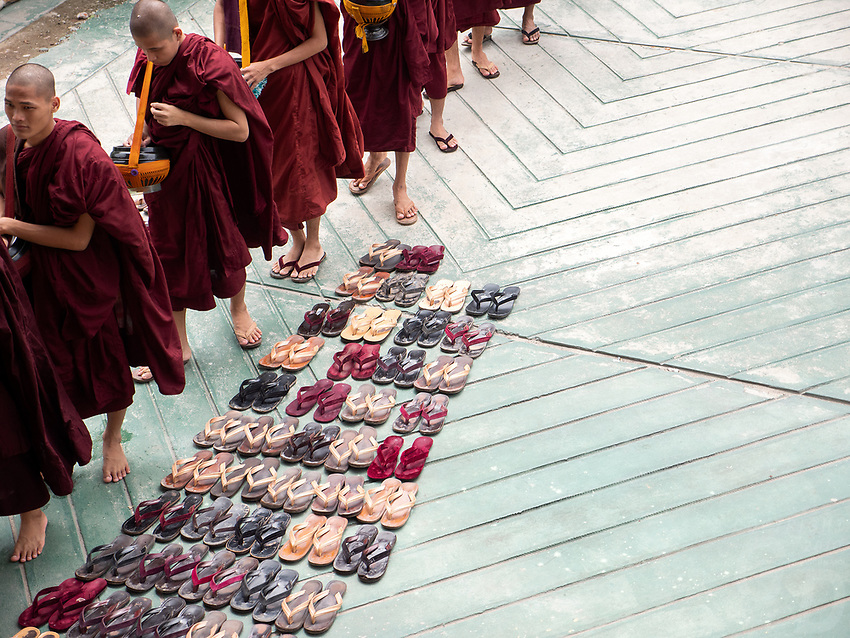 A Monastery in Mandalay, Myanmar Buddhist Monks lining up before their daily 11 AM lunch