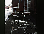 End view of C&amp;TS caboose #0503 parked alongside rotary snowplow #OY at Chama.<br /> C&amp;TS  Chama, NM